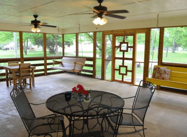 Screened in porch and furniture at the Fuller House