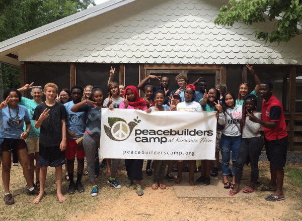 Peacebuilders Campers with banner
