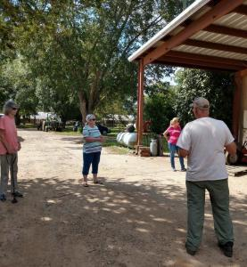 Jim Dubay leads tour of pecan plants at Koinonia Farm.