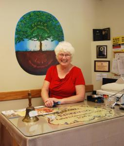 Carol Schuster at Welcome Center Desk