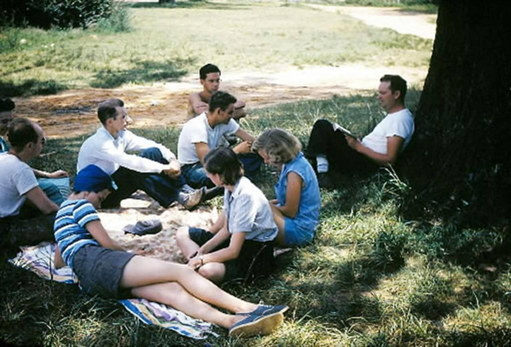 Clarence Jordan teaches a group of student outside under a tree