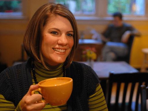 Rachel Held Evans holding a yellow coffee mug
